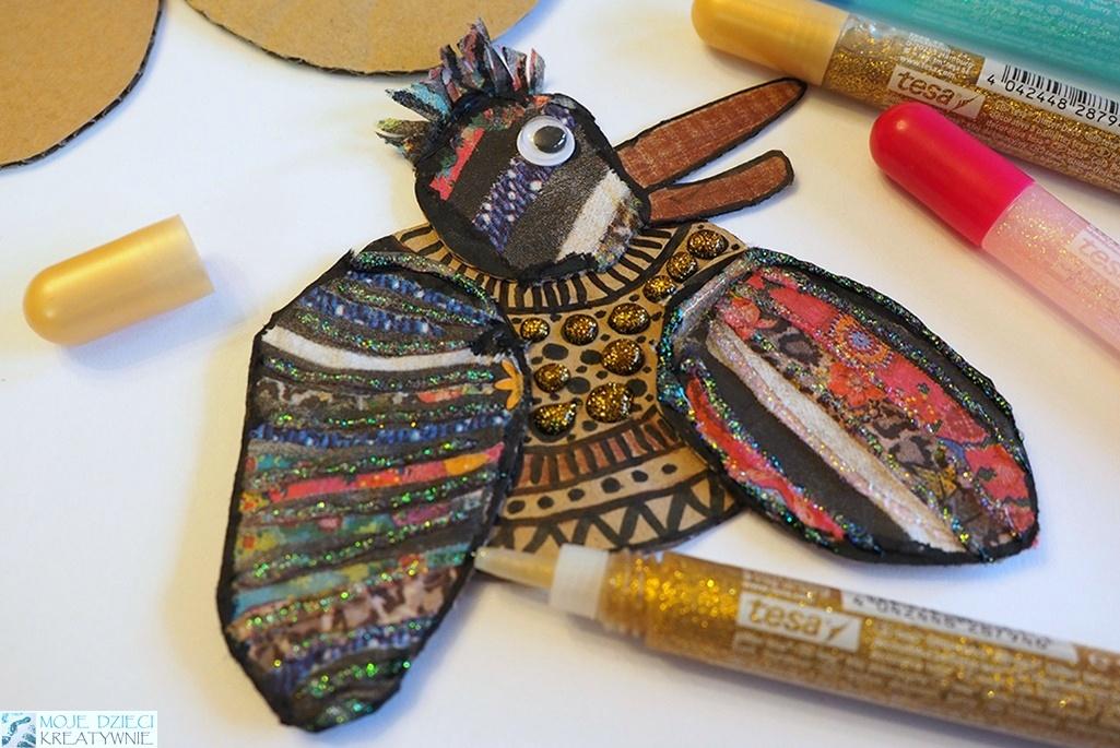 Kreatywne prace plastyczne na jesień w przedszkolu i szkole, ptak z papieru dekorowany brokatem.